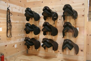 Saddles resting gently protected by Save Your Saddle Racks